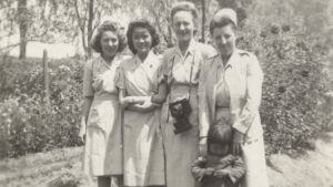 Archival black and white photo of women in nursing uniforms