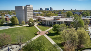 Aerial view of campus with downtown Greensboro in background