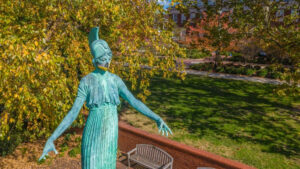 Minerva statue wearing a UNCG face covering