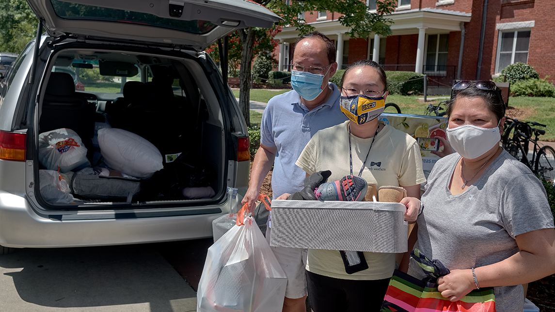 Kathy Hoang with her parents Ninh and Ann moving into North Spencer Residence Hall