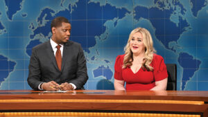Cast members at newsdesk during Saturday Night Live filming