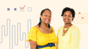 two women posing with graphics