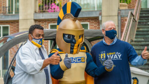 two men with Spartan mascot